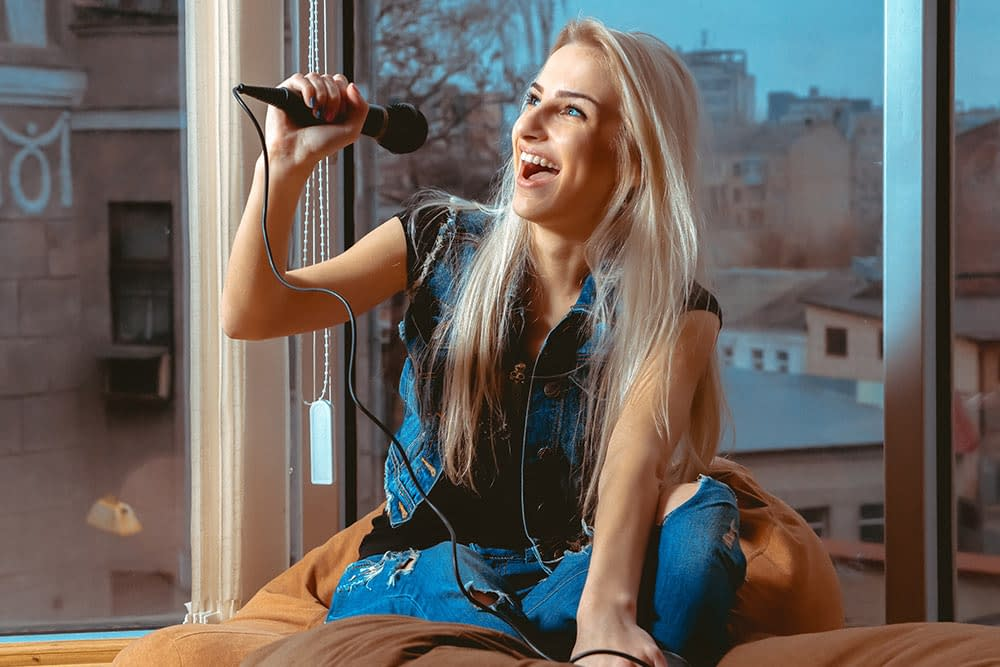 Girl singing at Virtually Talented Online Team Event